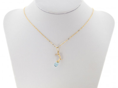 BLOSSOMING TWIG | Solid Gold necklace with Sky Blue Topaz