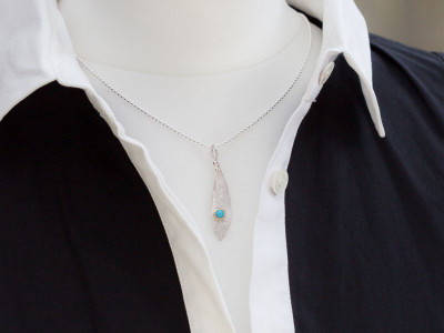 OLIVE LEAF   Silver necklace with a Turquoise in a Gold bezel