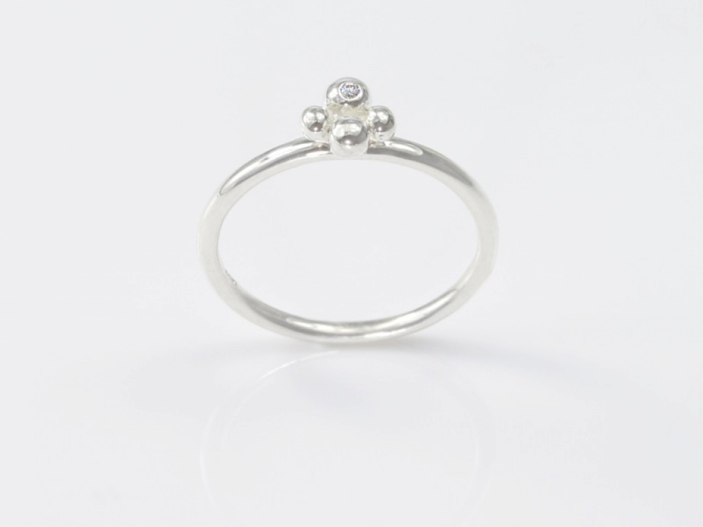 Crystal Flower Sterling Silver ring with a round facetted Quartz