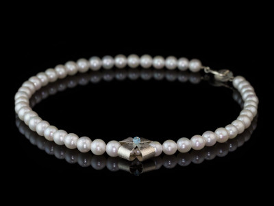 RIBBON CROSS PEARL NECKLACE   with Topaz on Silver Bow (sold)