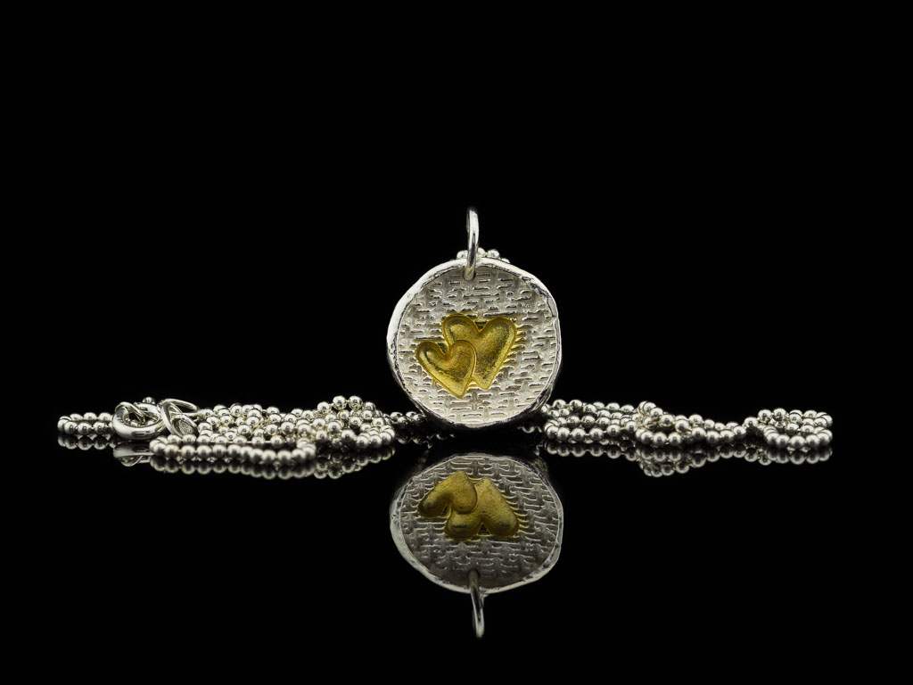 TWO HEARTS   Sterling Silver necklace with Gold