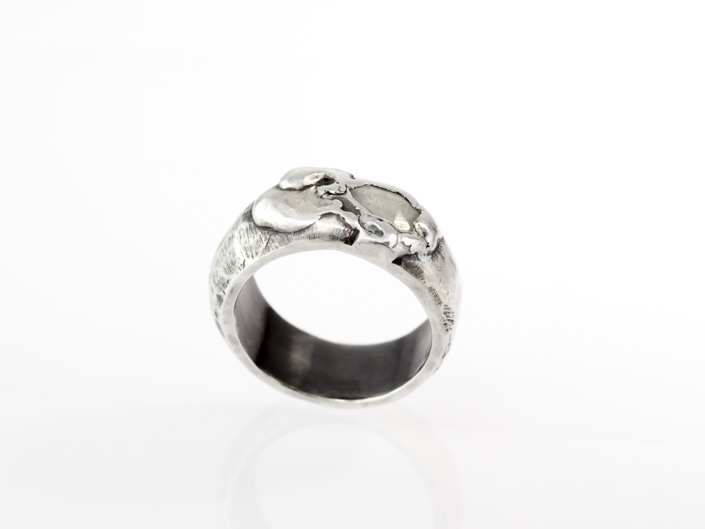 white emerald on black silver ring in sterling silver