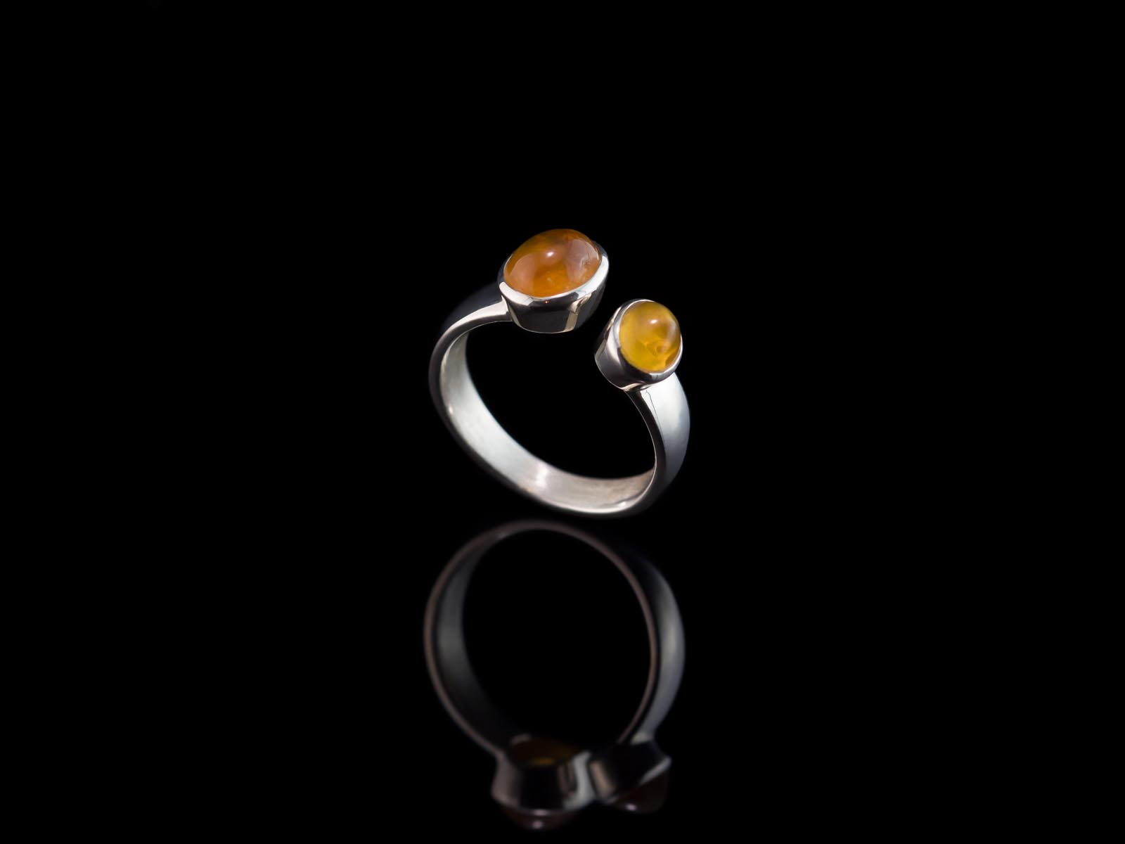 placed prong img measures size antique mandarin centrally a rings this gold ring flanked that elegant by set estate in vintage black features sapphire star fine yellow very scroll oval approx cut cabochon