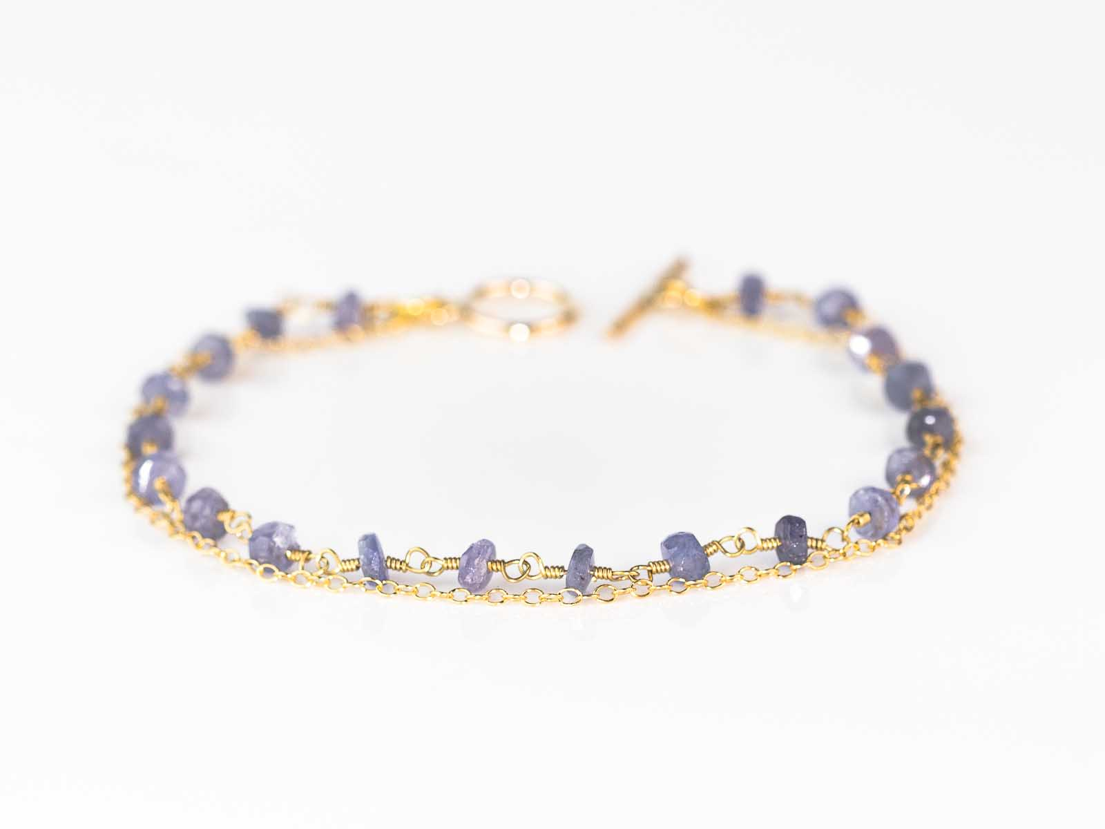 white in gold evert and diamond tennis tanzanite bracelet